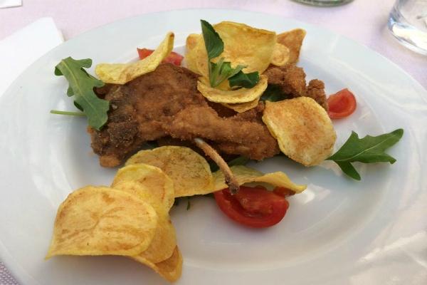 cesare al casaletto ristorante tipico romano cucina abbacchio costolette fritte dove mangiare migliore abbacchio a roma